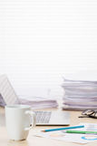 Office workplace with coffee cup, laptop and supplies Royalty Free Stock Images