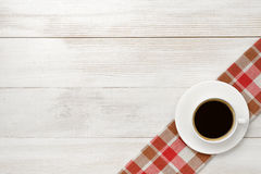 Office workplace with cup of coffee on checkered tablecloth Royalty Free Stock Images