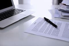 Office workplace with a laptop and contract document Stock Photo