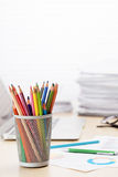 Office workplace with laptop, reports and pencils Royalty Free Stock Image