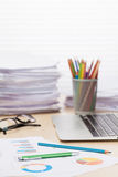 Office workplace with laptop, reports and pencils Royalty Free Stock Photography