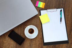 Office workplace with laptop, smart phone and coffee cup on wood table Stock Photos