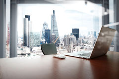 Office workplace with laptop and smart phone on wood table Royalty Free Stock Photography