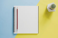 Office workplace minimal concept. Blank notebook, cactus, pencil stock images