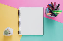 Office workplace minimal concept. Blank notebook, color pen box, Stock Image