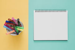 Office workplace minimal concept. Blank notebook, color pen box stock photography