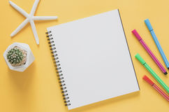 Office workplace minimal concept. Blank notebook with starfishes Stock Images