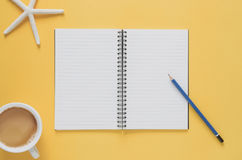 Office workplace minimal concept. Blank notebook with starfishes Royalty Free Stock Photo
