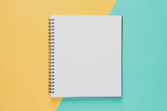 Office workplace minimal concept. Blank notebook on yellow and b stock photos