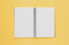 Office workplace minimal concept. Blank notebook on yellow backg Royalty Free Stock Photos