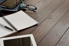 Office workplace. Open notebook, tablet computer, glasses, ballpoint and leather business folders on the office table. Top view. Free space for text. Сopy Royalty Free Stock Images