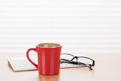 Office workplace with pc, glasses and coffee Royalty Free Stock Image