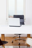 Office workplace table and laptop white background Royalty Free Stock Photos