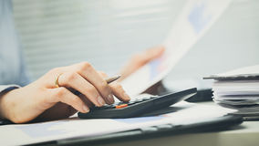 Office Workplace - Using Calculator Royalty Free Stock Photography