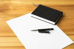 Office workplace on wood table. Vertical image. Minimalism.  stock images