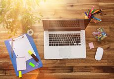Office workplace with wooden desk. Royalty Free Stock Photos