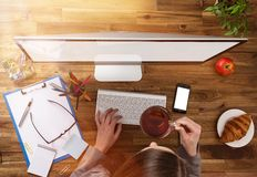 Office workplace with wooden desk. Royalty Free Stock Images