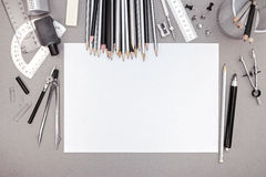 Office workspace with blank paper, pencils and various drawing t stock photo