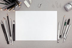 Office workspace with blank paper sheet and various drawing tool Stock Photography