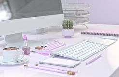 Office workspace with computer, pink stationery set, smartphone and cup of coffee. 3D illustration royalty free illustration