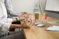 Office yoga for relaxation concept, female hands in mudra, close. Office yoga for relaxation or concentration concept, calm businesswoman meditating at work Stock Photography
