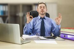 Free Office Zen. Relaxed Male Entrepreneur Meditating At Workplace, Coping With Stress At Work, Sitting At Desk With Eyes Closed Royalty Free Stock Images - 216851739