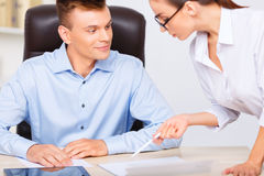 Officeman admires his assistants beauty instead of Royalty Free Stock Photography