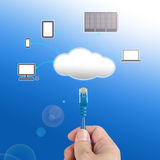 Officeman hold  Network cable  connect to cloud computing servic. E with blue background Royalty Free Stock Photo