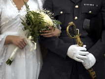Officer & Bride. Detail of a military wedding showing an officer and his bride Stock Photos