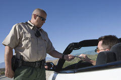 Officer Checking Middle Aged Man's License Stock Photography