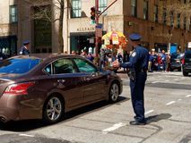 Officer directing traffic in Manhattan New York. New York City, USA - Apr 2018: Officer directing traffic in Manhattan Royalty Free Stock Photography