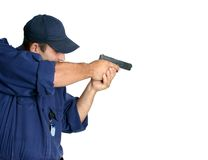 Officer on duty handling a weapon. Officer practising or using a weapon during duty, white background, space for text Stock Photo