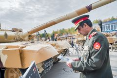 Officer of foreign army studies tank T-72. Russia Stock Photo