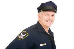 Officer Friendly. Friendly police officer isolated on a white background Royalty Free Stock Image