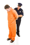 Officer Handcuffs Prisoner. Police officer placing handcuffs on prisoner in orange prison jumpsuit.  Full body isolated on white Royalty Free Stock Photography