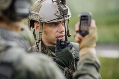 Free Officer Holds A Radio Station, And Give Orders Subdivision Stock Images - 56959574
