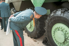 Officer of Kazakh army examine troop-carrier Stock Photos