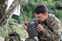 The officer of the marine corps announces on the radio. Soldiers of the Colombian army supervise the territory from revolutionaries of FARC Royalty Free Stock Image