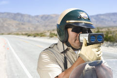 Officer Monitoring Speed Through Radar Gun Stock Photography