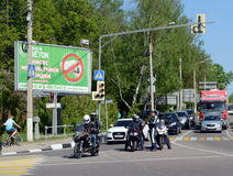 The officer of the police check documents of motorcyclists at the intersection. Stock Photography