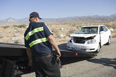 Officer With A Recovery Services Vehicle Royalty Free Stock Images