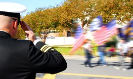 Officer saluting veterans royalty free stock photography