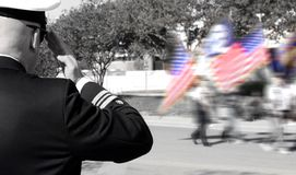 Officer saluting veterans Royalty Free Stock Photos