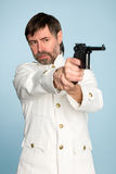 Officer shooting a gun. Man in the form of a naval officer's shooting a gun Royalty Free Stock Image