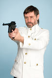 Officer shooting with a pistol. Naval officer, a pince-nez shooting with a pistol Royalty Free Stock Images