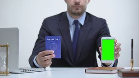 Officer showing passport and mobile phone, registration online for id card. Stock footage stock video footage