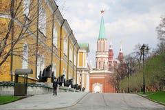 Officer stands near Kremlevskaya wall Royalty Free Stock Photography