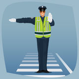Officer of traffic police standing at crossroads Royalty Free Stock Image