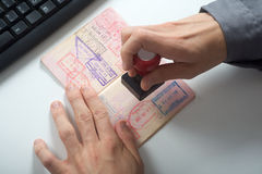 Officer will stamp in the passport. Immigration control officer will arrival stamp in the passport stock photography