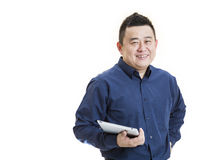 Officer worker. A positive Asian male office worker front view holding tablet on isolated white background Stock Photos